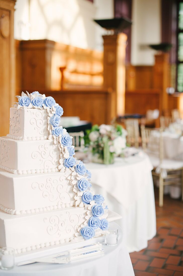 Tara and Evan ended the evening with a four tiered vanilla cake with a chocolate fudge filling. It had buttercream frosting and a cascade of light blue sugar roses that perfectly matched the pastel theme of the evening.