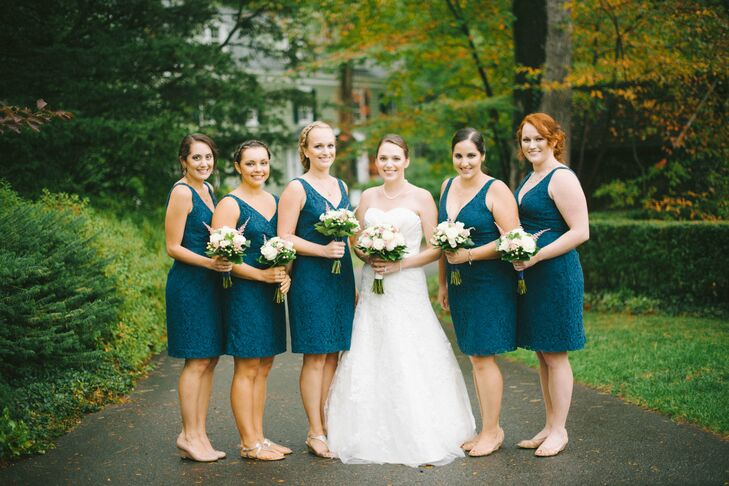 Emily's bridesmaids wore matching knee-length navy blue lace dresses with V necklines from J.Crew.