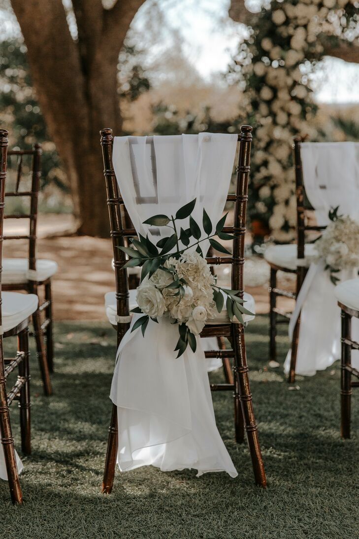 Neutral Chair Coverings with White Hydrangeas, Roses and Ranunculus