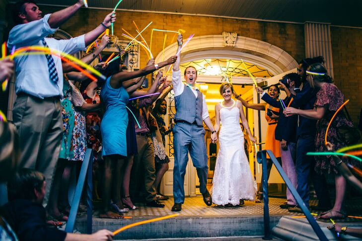 Though sparklers were off-limits at their venue, Melissa and Jonathan's send off was just as lively, with guests triumphantly waving colorful glow sticks as the couple made their exit from the historic mansion.