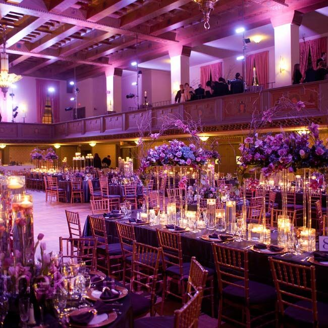 Cocktail hour took place on the wraparound balcony so that guests could enjoy the view of the purple-lit ballroom from above.