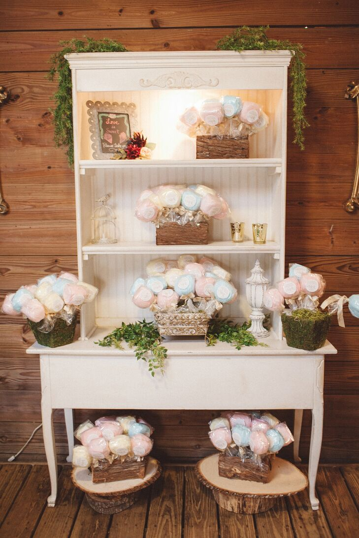 """The guests were given whimsical cotton candy lollipops as their wedding favors. A label with """"Thanks for making our day so much sweeter,"""" was placed on each blue raspberry, pina colada or pink vanilla flavored confection. """"I wanted a fun foodie gift that showed our playful side. They were displayed at the front of the barn,"""" says Nikole. For their guests preferred a different treat, the couple also had a gourmet coffee and hot chocolate bar in the barn's stable rooms."""