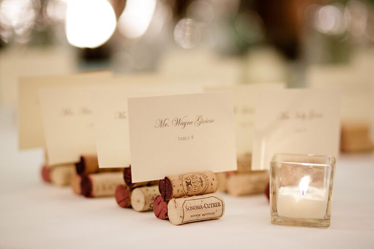 Over the course of their engagement, Amanda and Luke collected wine corks from friends and family that they later made into escort card holders. Rather than use a traditional guest book, the couple opted for bottles of wine and encouraged guests to sign the labels.