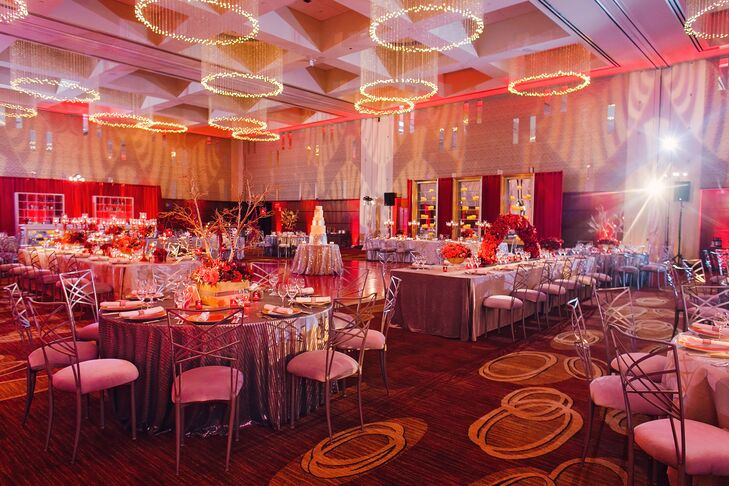 A custom red dance floor was installed to elevate the use of red throughout the room at the Four Seasons in St. Louis, Missouri.  Additionally, mirrors and candles were incorporated.