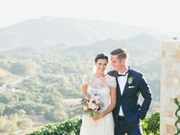 Bride and groom with California mountains behind them