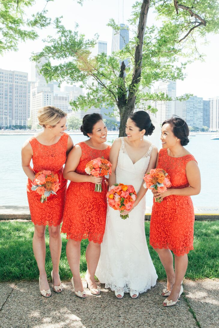 """""""I have seen and worn my share of awful bridesmaid dresses, so I wanted my bridesmaids to wear a dress that didn't look like a bridesmaid dress,"""" says Sara. Jenny Yoo's Harlow dress, a sleeveless lace number in a short, sheath silhouette, perfectly fit that description and the bold paprika color tied in seamlessly with the wedding's color palette. To complete the look, the girls donned gold satin peep toe pumps and simple pearl earrings."""