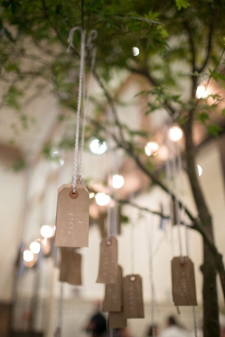 Simple brown escort tags were hung from tree branches at the reception.