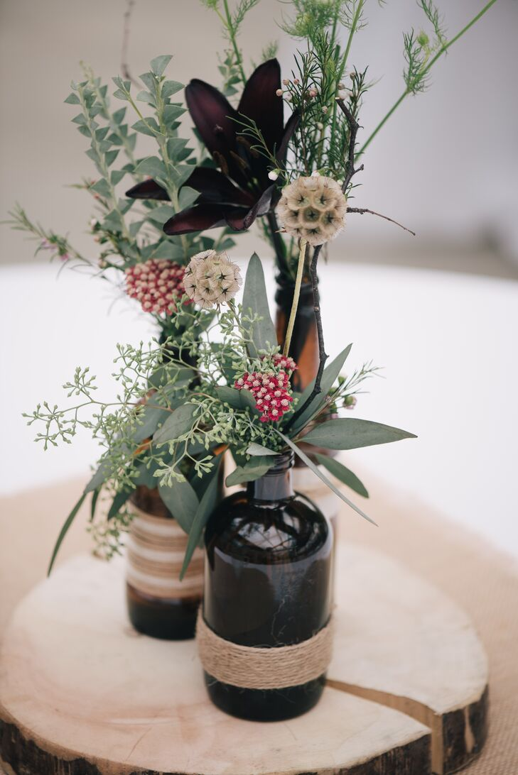 Scabiosa Pod and Eucalyptus Centerpieces in Twine-Wrapped Brown Bottles