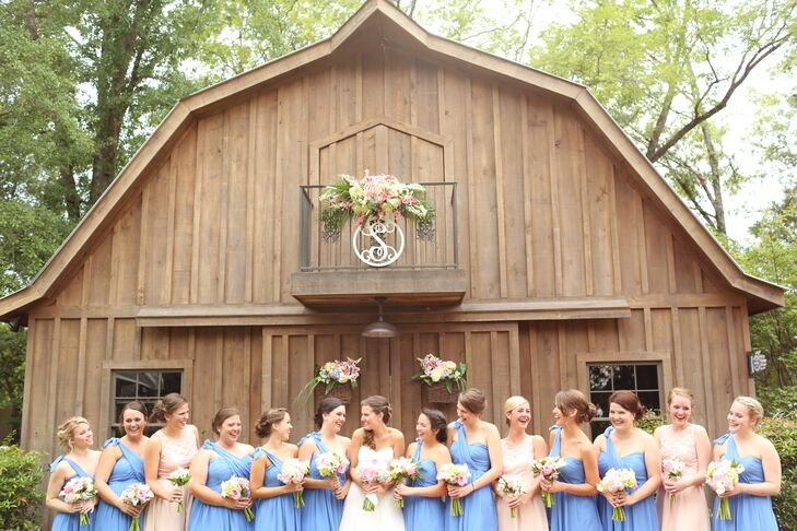The bride went with cornflower blue for her short bridesmaid dresses because she wanted a color that would stand out in photos. M
