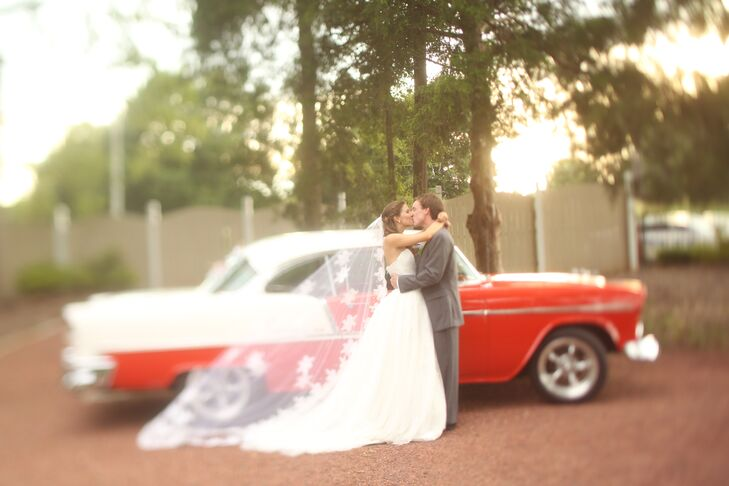Guests tossed lavender as the couple drove off in Tara's great uncle's vintage car.
