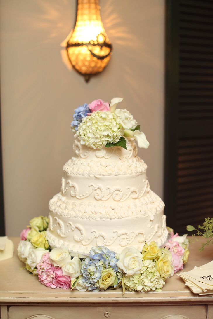 The romantic three-tiered buttercream was topped with pastel fresh flowers to add a soft feel.