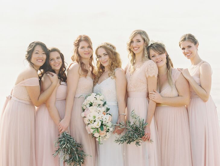 The bridesmaids each picked out a blush Jenny Yoo dress in styles of their choosing, paired with accessories the girls picked out for themselves as well. The light shade of pink perfectly followed the day's romantic palette.