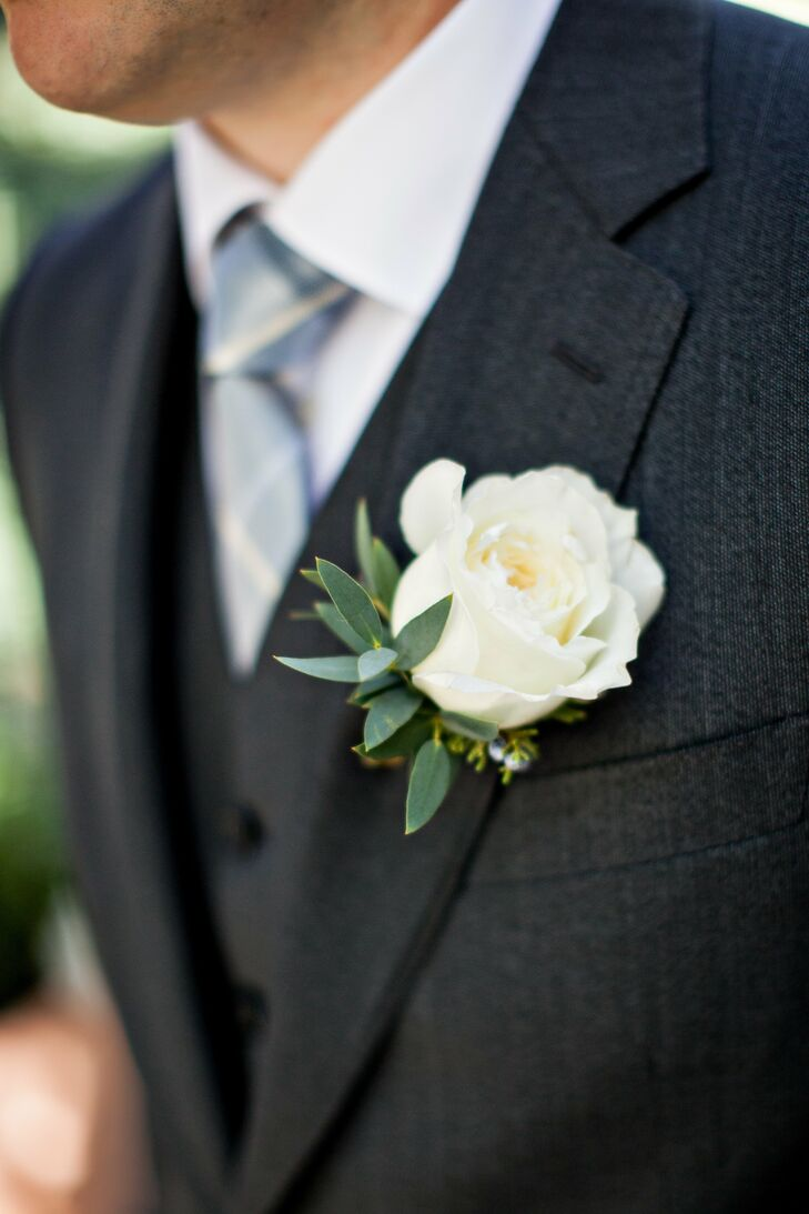 Steve adorned his lapel with a single ivory rose.