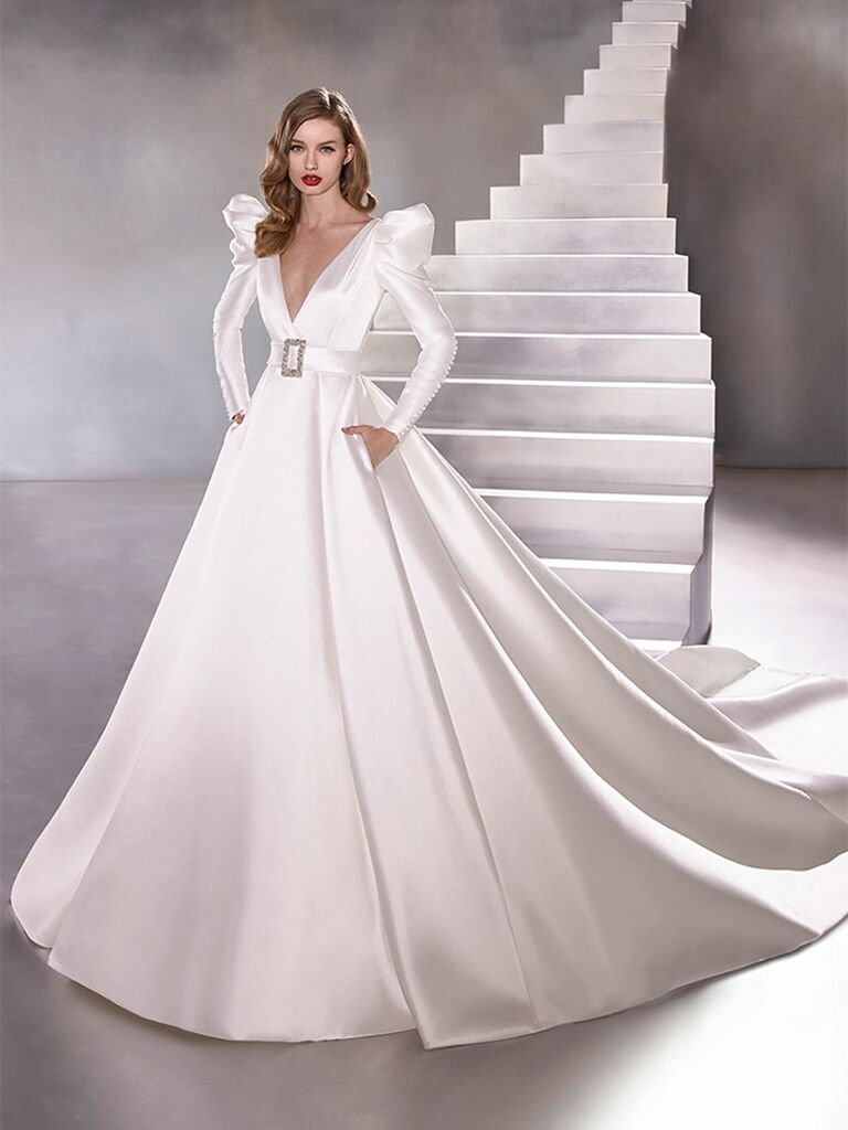 Atelier Provonias wedding dress belted ball gown with strong shoulders