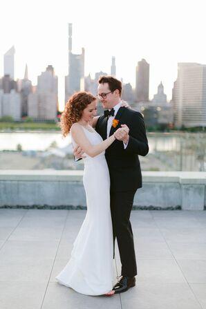 Modern Couple Wearing Simple Wedding Dress and Black Tuxedo