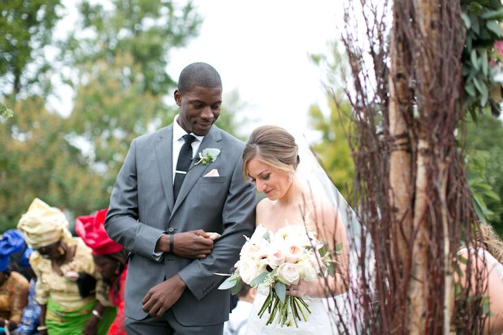 Jessica carried peach garden roses, ivory spray roses, white astilbe and seeded eucalyptus in her stunning bouquet. She loved that the lush florals were classic and boho with the neutral colors and textured look.
