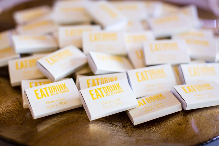 Small boxes of matches, printed with the phrase Eat Drink and Be Married, tied in with the celebration's cheery yellow palette.