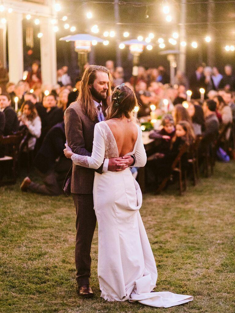 Indie bride and groom dancing during outdoor wedding reception