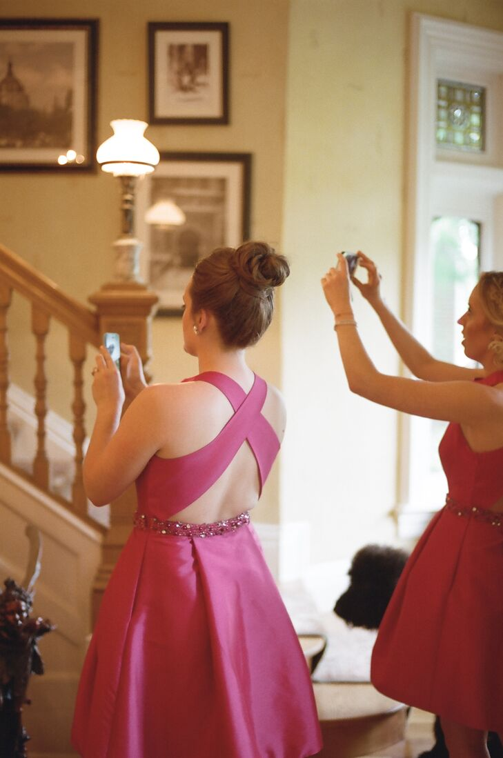 The bridesmaids captured Jennifer's entrance from the bottom of the stairs at the Saint Paul Hotel in St. Paul.