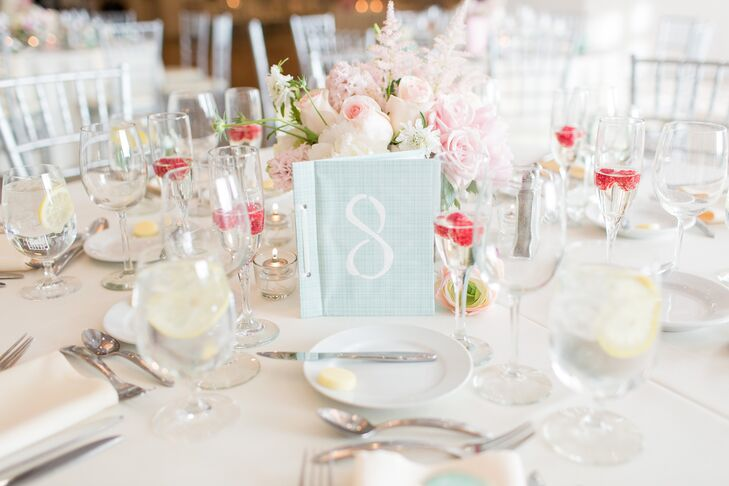 Instead of a classic guest book, Gina and Steven decided to make their table numbers do double duty, writing each on a handcrafted, mint-colored book. Guests were able to write their well wishes and advice for the newlyweds inside the booklets, which the couple would later read on their corresponding anniversary.