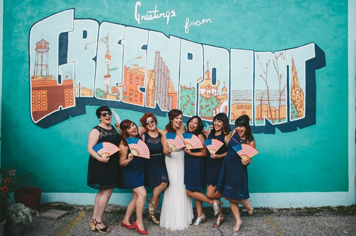 "Jen's six bridesmaids wore short navy dresses of their choosing from Modcloth, Forever21 and Gather & Gown with metallic shoes and their own jewelry. ""I wanted them to look comfortable and not overdressed for the wedding's casual vibe,"" says Jen. ""Fun sunglasses were encouraged."""