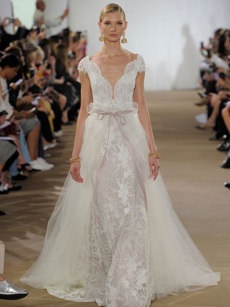 Ines Di Santo Fall 2019 lace wedding dress with a tulle overlay train, front bow detail and plunging scalloped neckline
