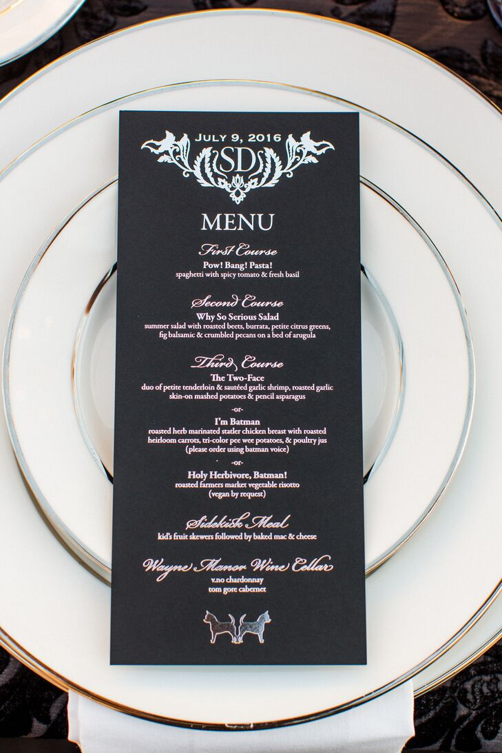 "At dinner, silver foil-stamped menus outlined fun ""Batman""-themed entrees, such as the ""two-face"" surf-and-turf option."
