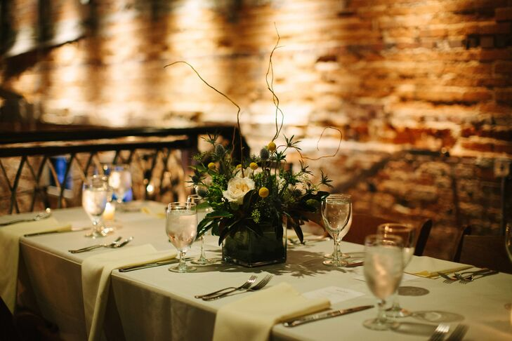 """""""The Cookery is an awesome old industrial space in downtown Durham full of iron and reclaimed wood,"""" says Tessa. """"We wanted everything to feel casual and match well with the venue, and I didn't want to be too strict about the color palette."""""""