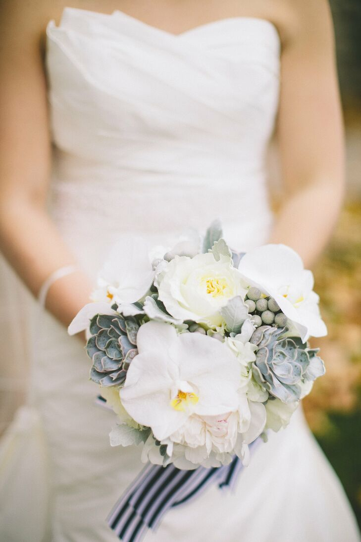 The bridal bouquet was a mix of bright white flowers accented by clean, natural succulents.