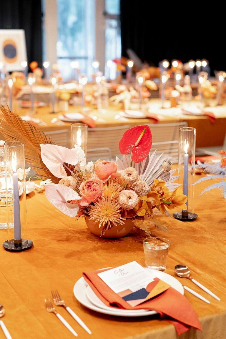 Orange centerpiece with anthurium and spider mum blooms