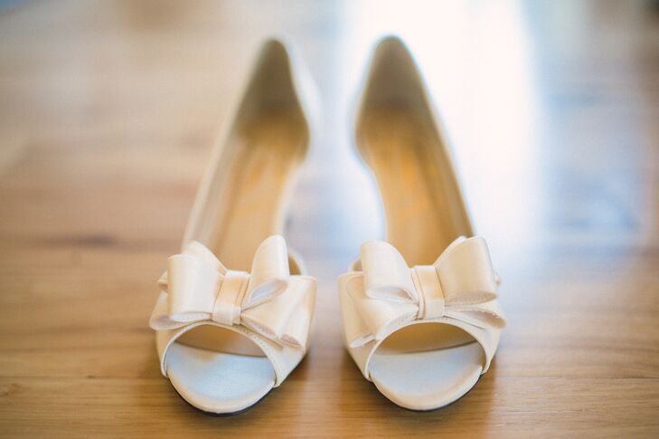 Since the ceremony was outdoors, the bride opted for a pair of wedges by J. Renee to make it easier to walk on the property's lawn.