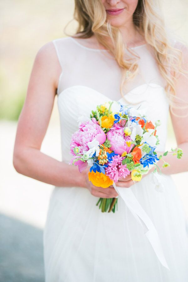 Christine carried a bright bouquet made up of all her favorite flowers. It included pink peonies, orange roses and pink hyacinths. The arrangement was created by Black Earth Floral Gallery.