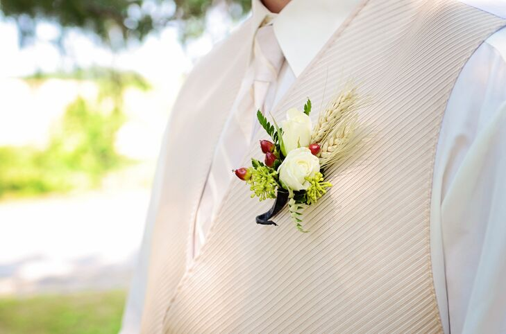The couple's florist used a mix of wildflowers and wheat to give each arrangement and boutonniere a rustic touch.