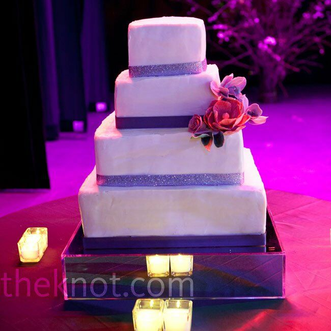 Alternating deep purple and glittered lavender ribbon trimmed each tier of the square wedding cake.