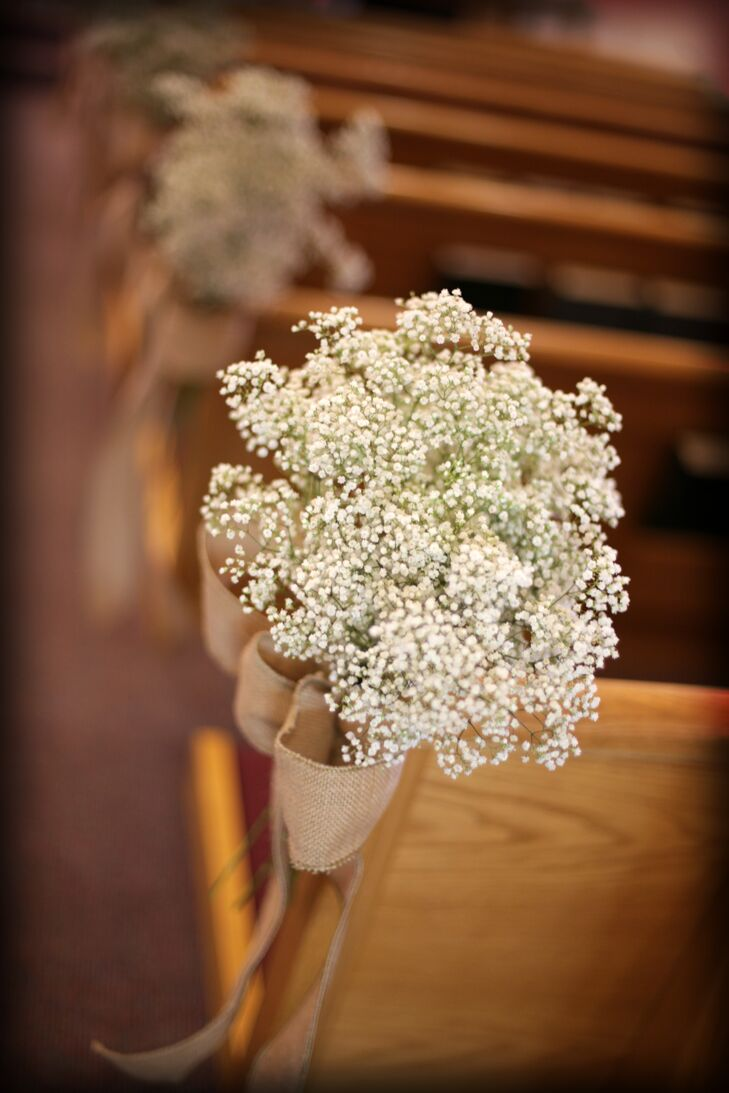 """The pews at the church were lined with burlap and baby's breath -- very simple, but beautiful,"" Ashleigh says."
