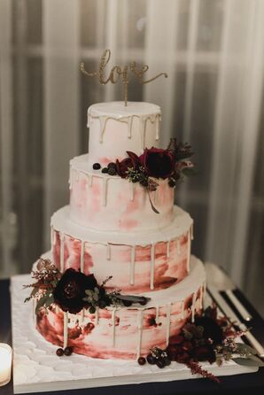 A Blush and Burgundy Watercolor Cake with a Topper and Dahlias