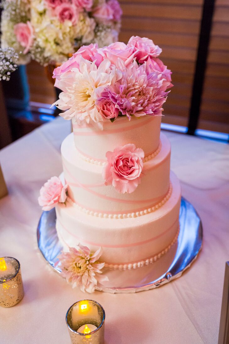 Three-Tier White Wedding Cake with Pink Flowers