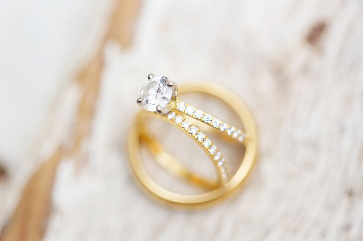 A gold wedding band with pavé-set diamonds complemented Bernadette's beautiful diamond solitaire engagement ring.