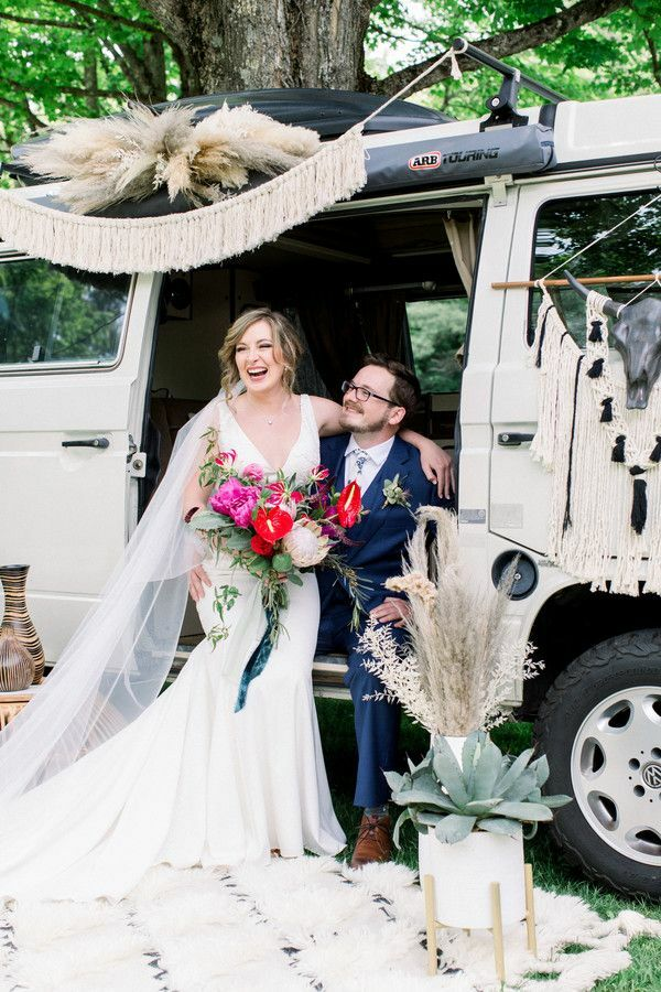Couple sitting in van photo booth surrounded by macrame details