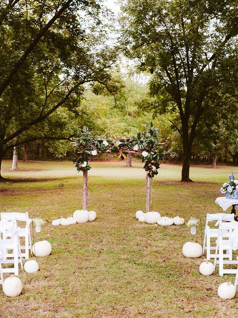 Rustic wedding ceremony decor idea with white pumpkins