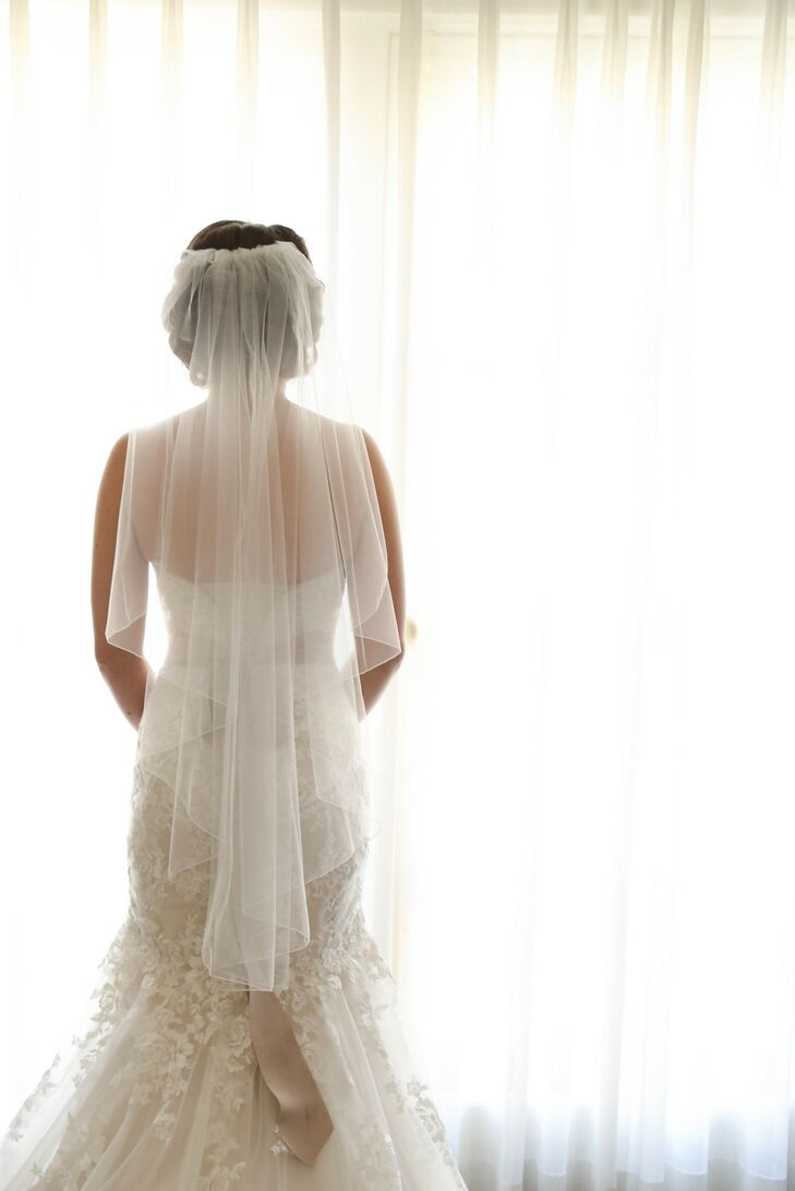 """""""The first dress I tried on while searching for """"the one"""" was a Maggie Sottero embroidered lace fit and flare gown,"""" says Samantha. """"The dress had a strapless sweetheart finish with a corset back closure."""" rn"""