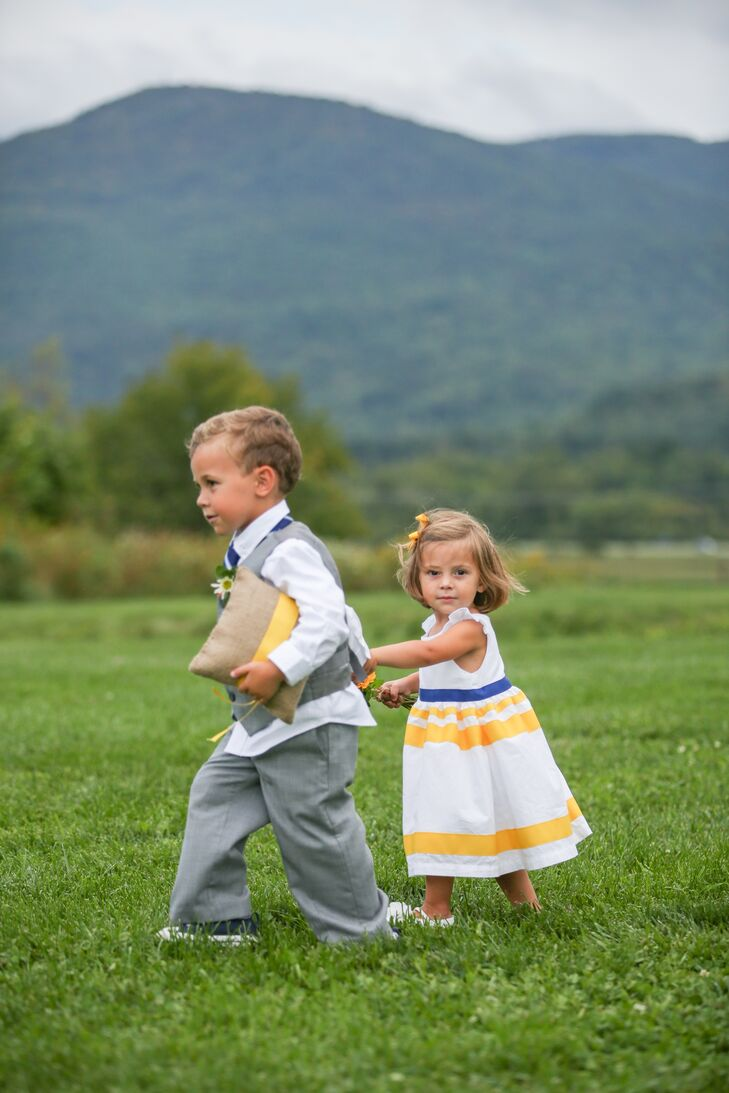 The flower girl wore a white dress with ruffled cap sleeves and cheerful yellow stripes.
