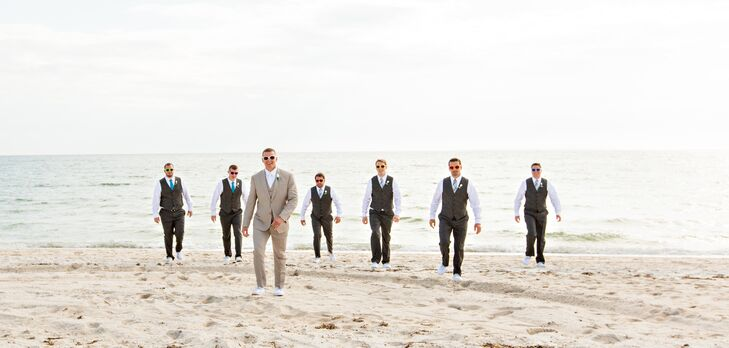 """The men were in Perry Ellis suits,"" Amanda says. ""The groomsmen wore the pants, vest and a tie that was given to them as a gift while Mike wore the three piece suit and a white tie to match my dress. They also wore white Polo boat shoes which really made the colors of the suit come together."""