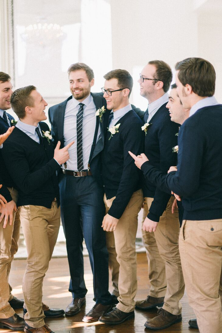 """We wanted to select an outfit that was not only affordable, but an outfit they could wear again,"" says Elena. The groomsmen wore navy blue cardigans and bowties, light blue dress shirts, and khaki pants."