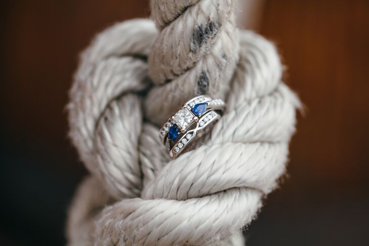 Kate's engagement ring features a princess cut diamond in the center with a pear cut sapphire on either side. Andy sold his 1971 Delta 88 Oldsmobile and his beloved motorcycle to get Kate the perfect ring.