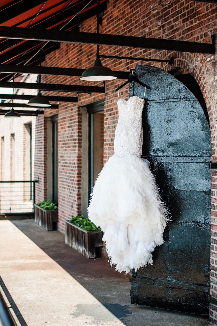 """When it came to choosing a gown, Hayley knew she wanted a mermaid silhouette and plenty of bling. A Stephen Yearick mermaid gown with beaded embellishments, floral appliques and a feathered organza skirt fit the bill. """"I think I only tried on three or four gowns before selecting 'the one,'"""" says Haley. """"It was unlike anything I had ever seen. It was fashion-forward, but still bridal."""" She accessorized with a diamond tennis bracelet that had belonged to Jared's mother and a crystal headband for a bit of added glitz. """"I never got to meet Jared's mother, but it felt really special to have a part of her with us on our wedding day,"""" she says."""