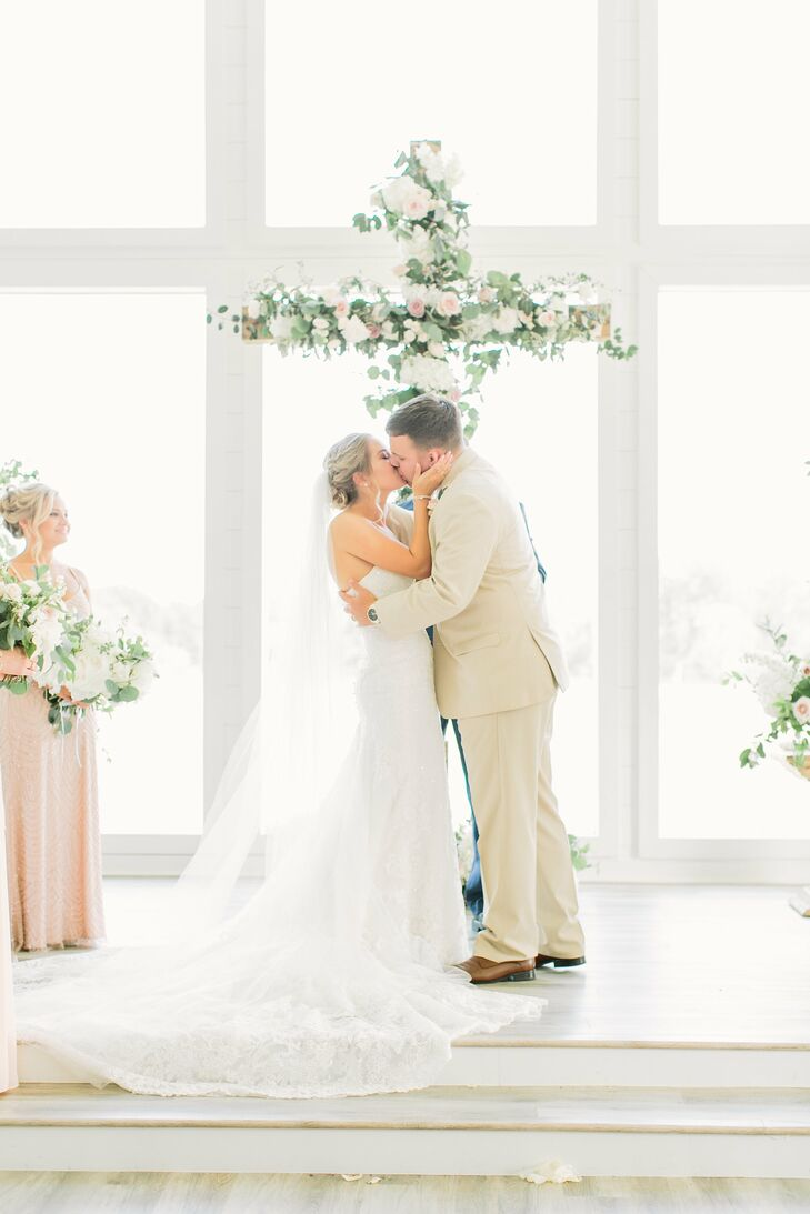 First Kiss in Front of Flower-Covered Cross