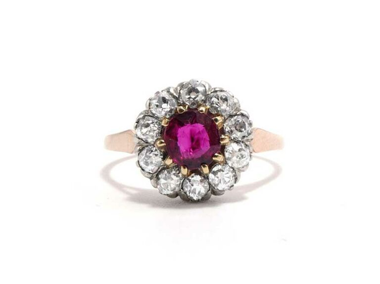 Ruby engagement ring with diamond halo cluster