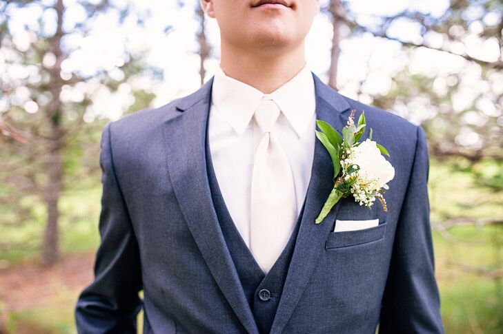 Green and White Boutonniere with White Tie