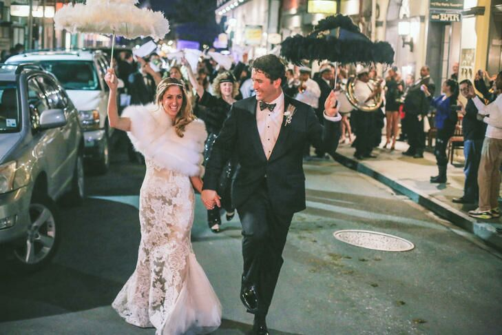 Couple marching in a traditional New Orleans second line